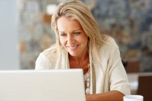 photodune-214673-happy-middle-aged-woman-using-laptop-s