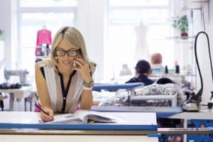 32260548 - young self employed woman taking customer orders by phone